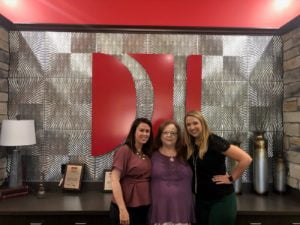 Attorneys Melissa Pope and Jessica Brunken with client P.H.