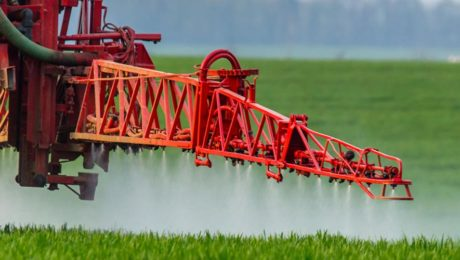Roundup weed killer being sprayed on a field