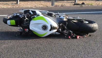 Motorcycle wrecked in roadway
