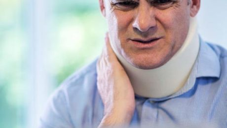 Mature man with whiplash injury