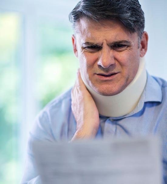 Mature man with whiplash injury