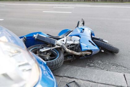 Motorcycle and Car Accident in Roadway