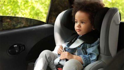 Young child in car seat.