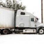 Wrecked Semi Truck in Snowy Ditch
