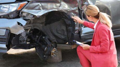 Kansas Car Wreck Settlement Adjuster Inspecting Vehicle