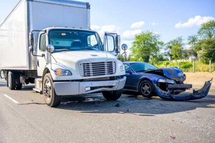 Semi-truck and car collide on highway
