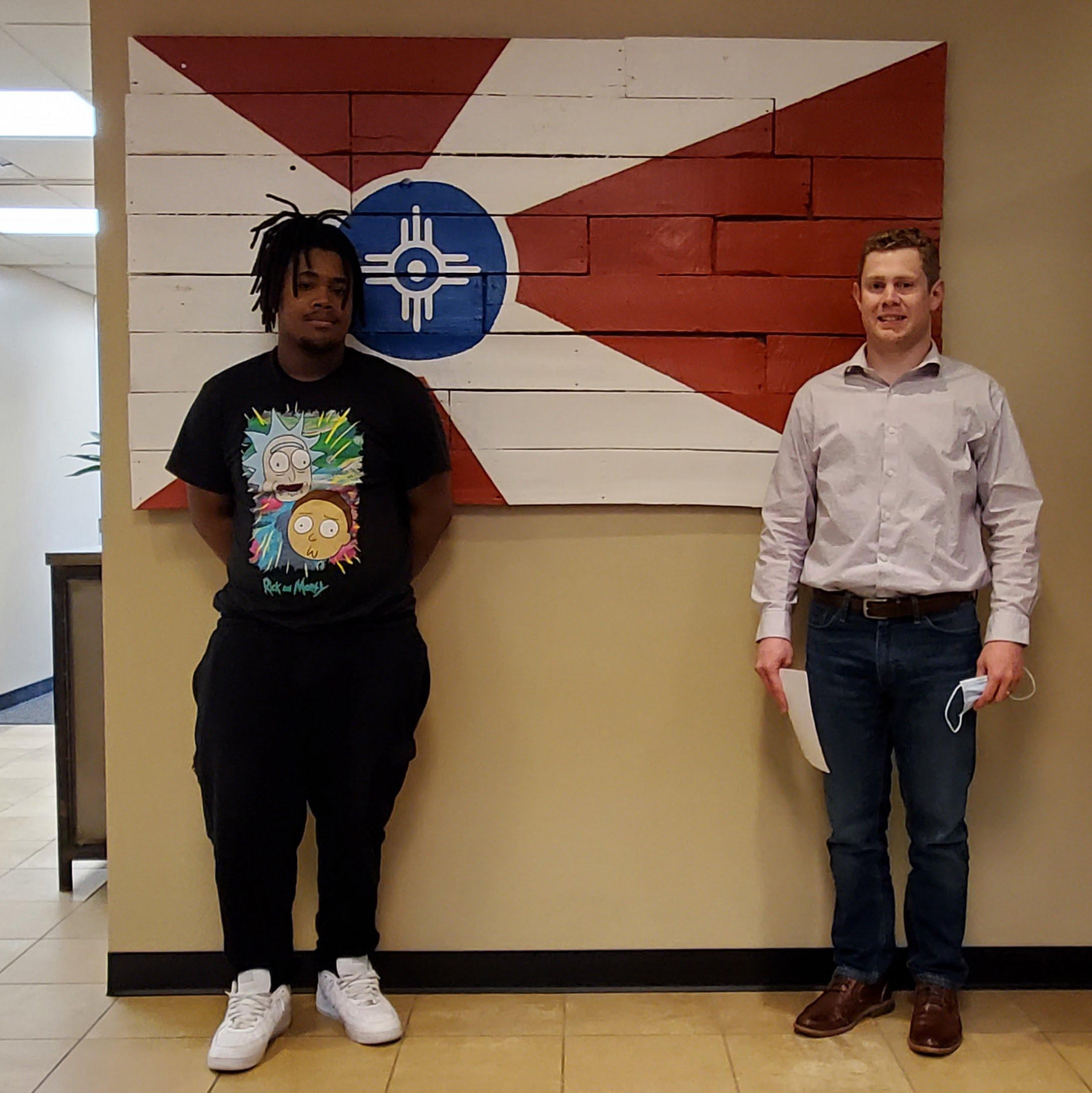 Attorney Shawn Aldrich with client D.W.