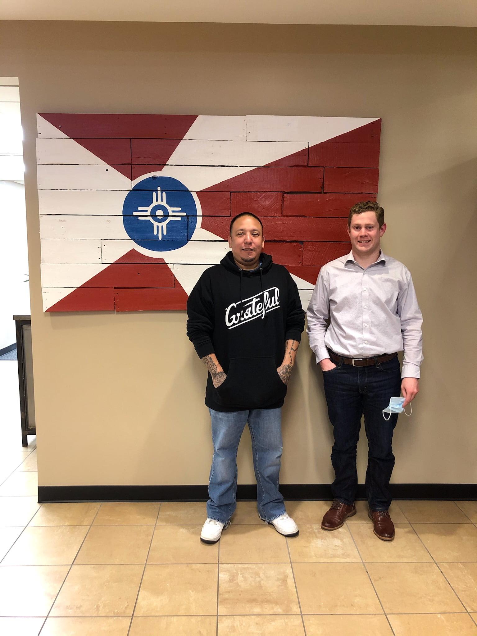 Attorney Shawn Aldrich with client J.C.