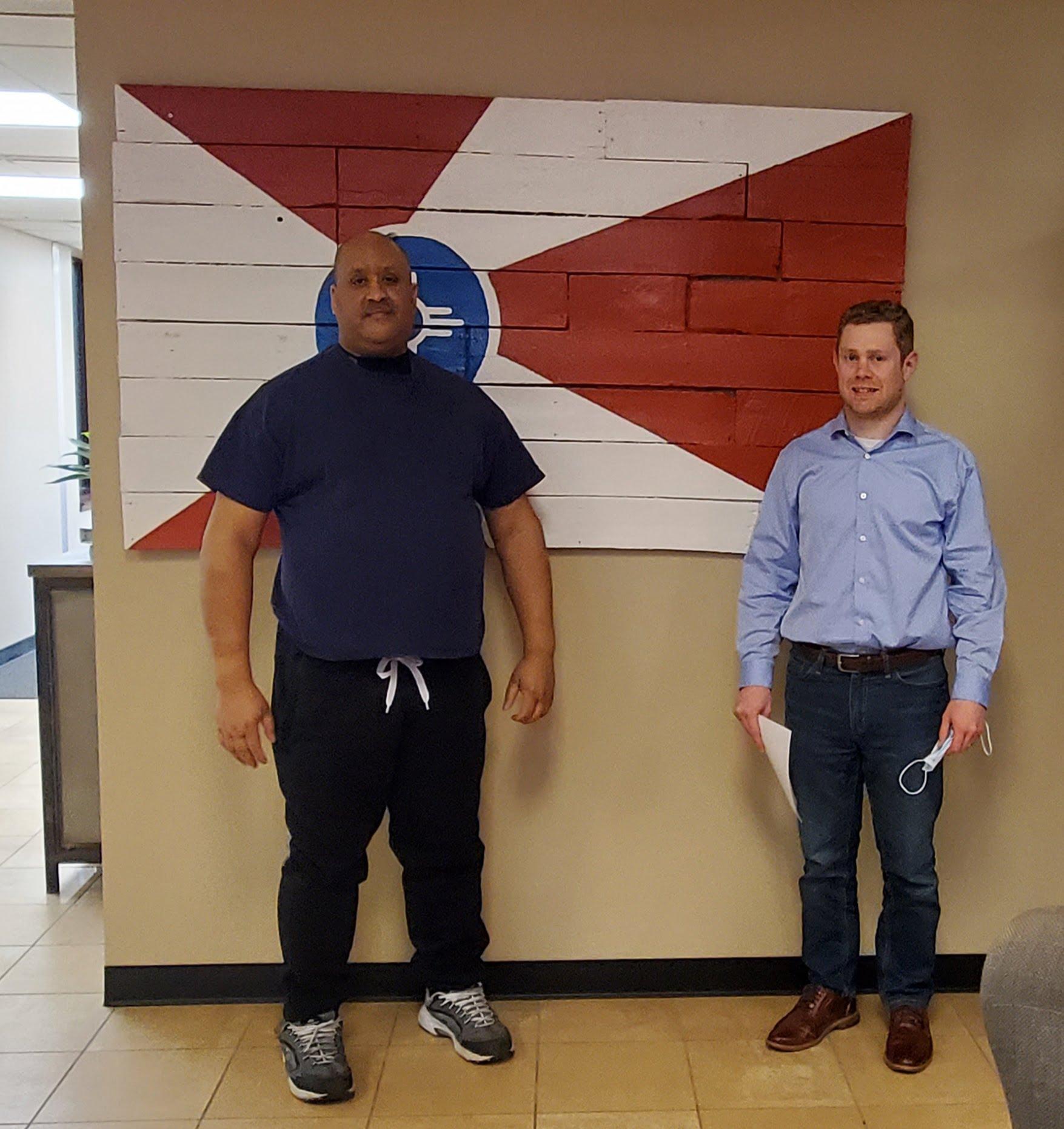 Attorney Shawn Aldrich with client S.H.