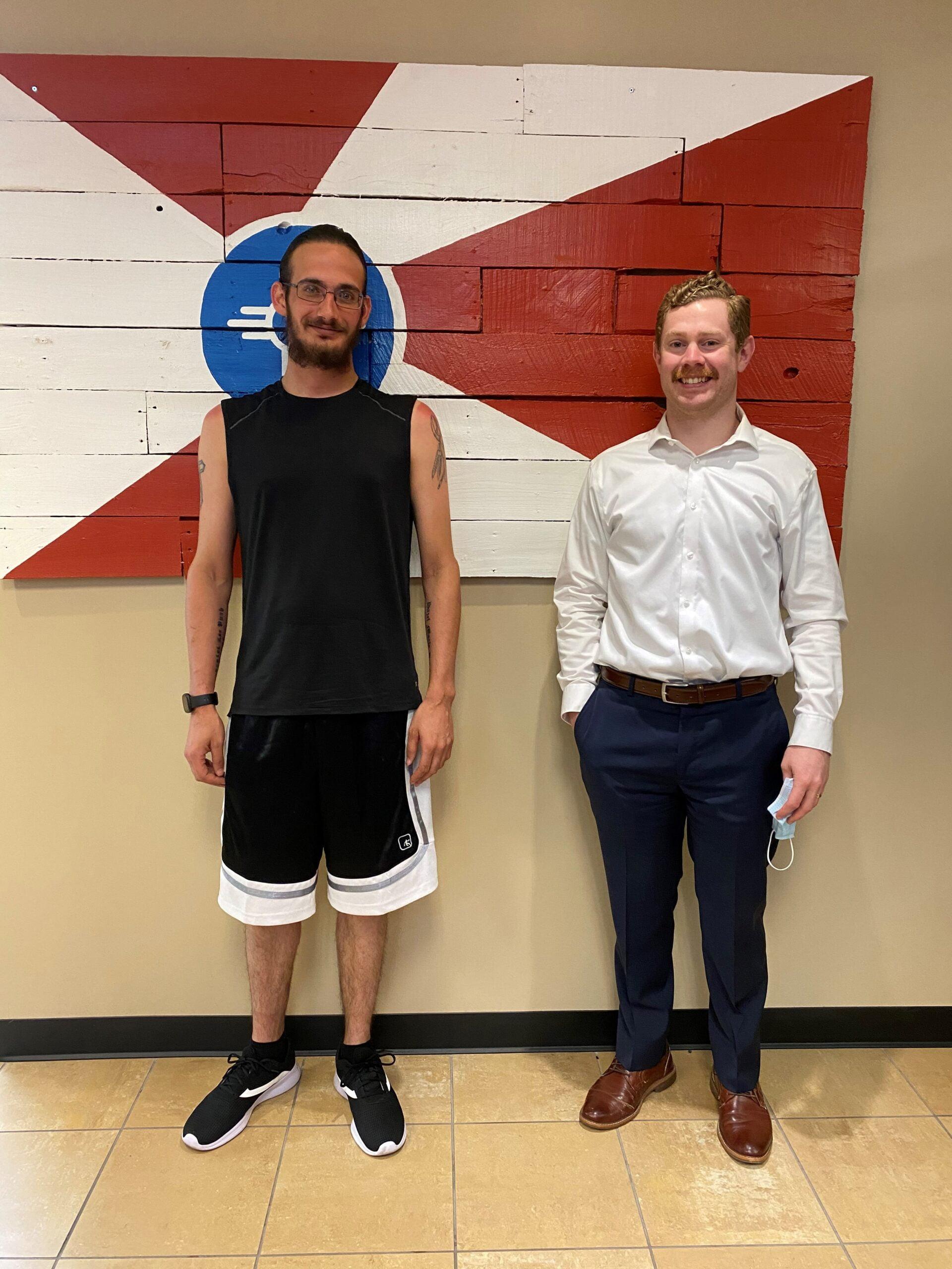 Attorney Shawn Aldrich with client J.P.