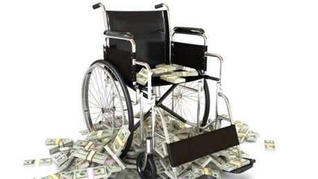 Wheelchair with pile of money indicating high medical costs